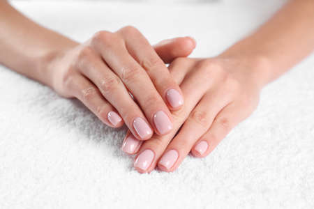 Closeup view of beautiful female hands on towel. Spa treatment Reklamní fotografie - 121987997