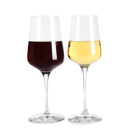 Glasses of different delicious expensive wines on white background