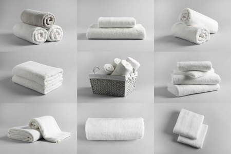 Collage of different clean terry towels on light background Stock Photo