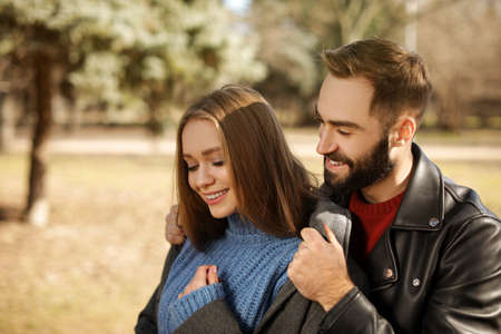 Portrait of cute young couple in park on sunny day