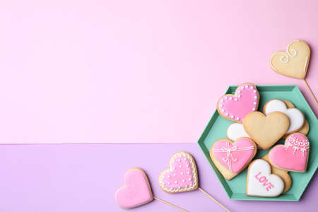 Flat lay composition with heart shaped cookies on color background. Space for text Stock Photo