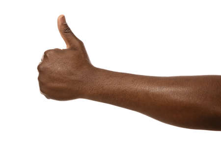 African-American man showing thumb up gesture on white background, closeup