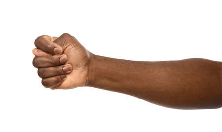 African-American man showing fig gesture on white background, closeup Foto de archivo