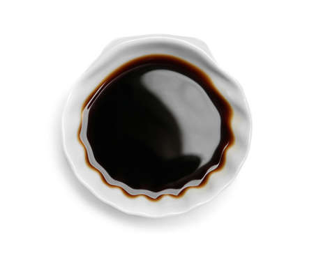 Bowl of soy sauce on white background, top view
