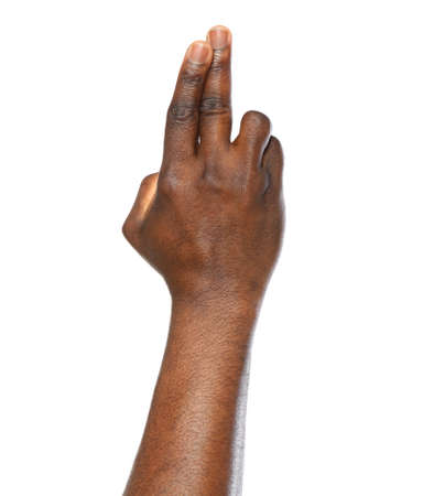 African-American man making promise on white background, closeup