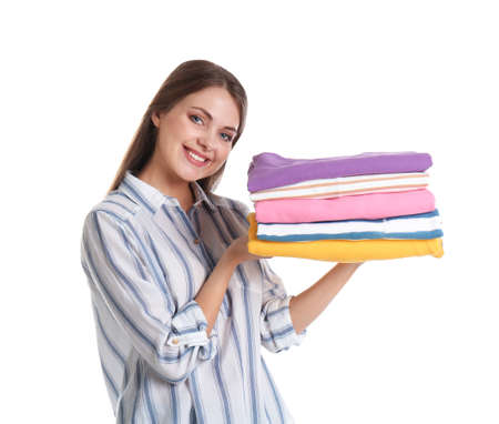 Happy young woman holding clean towels on white background. Laundry day Banco de Imagens