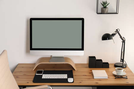 Stylish workplace interior with modern computer on table. Mockup for design 스톡 콘텐츠