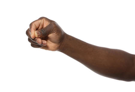 African-American man holding something in hand on white background, closeup