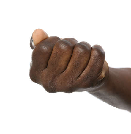African-American man showing fist on white background, closeup