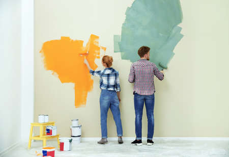 Young couple painting wall indoors. Home repair 免版税图像 - 122517114
