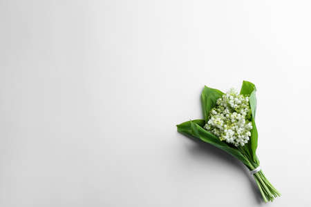Beautiful lily of the valley bouquet on white background, top view. Space for text Фото со стока - 122517149