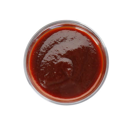 Glass bowl of barbecue sauce on white background, top view