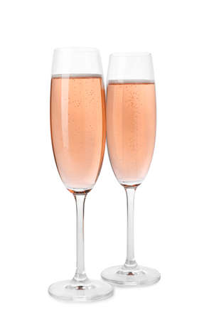 Glasses of rose champagne isolated on white