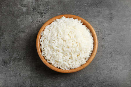 Bowl of tasty cooked rice on grey background, top view Reklamní fotografie