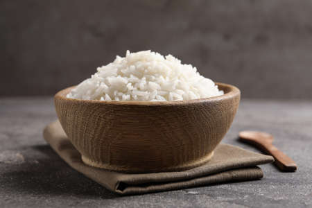 Bowl of tasty cooked rice served on table