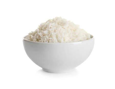 Bowl of tasty cooked rice on white background