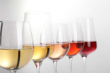 Row of glasses with different wines on white background 写真素材