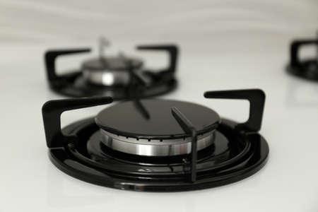 Modern built-in gas cooktop, closeup. Kitchen appliance