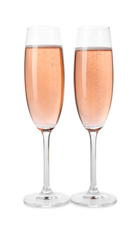 Glasses of rose champagne isolated on white Imagens