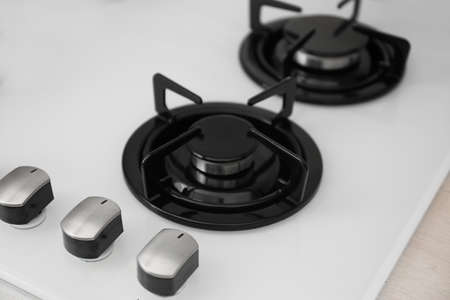 Modern built-in gas cooktop, closeup. Kitchen appliance