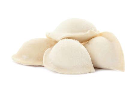 Heap of raw dumplings on white background