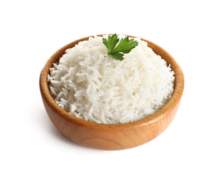 Bowl of tasty cooked rice with parsley on white background