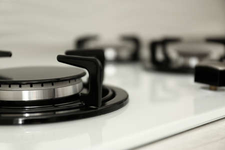 Modern built-in gas cooktop, closeup with space for text. Kitchen appliance Stock Photo