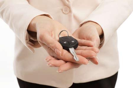 Woman holding car key isolated on white 版權商用圖片