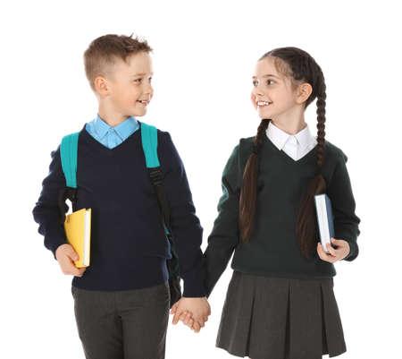 Portret van schattige kinderen in schooluniform op witte achtergrond Stockfoto