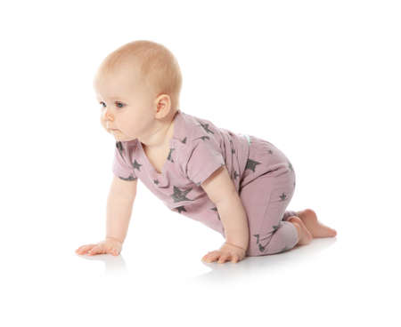 Cute little baby crawling on white background