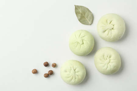 Composition with raw dumplings, bay leaf and pepper on white background, top view Banco de Imagens