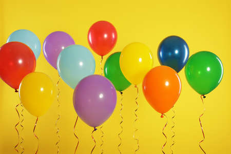 Bright balloons on color background. Celebration time Banque d'images - 123097954