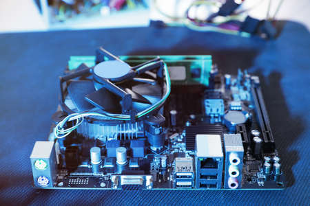 Motherboard on table, closeup. Computer repair service Imagens