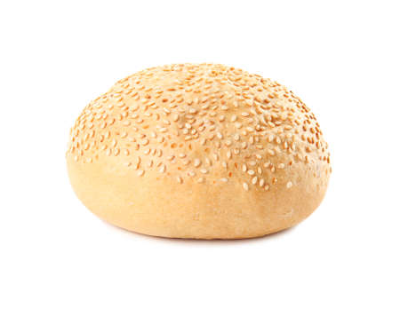Bun with sesame seeds isolated on white. Fresh bread