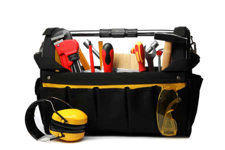 Bag with different construction tools isolated on white