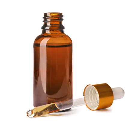 Cosmetic bottle and pipette with essential oil on white background