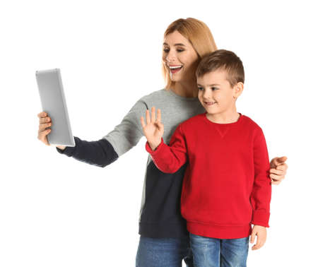 Mother and her son using video chat on tablet against white background