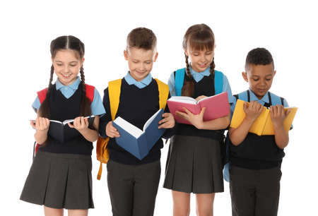 Portrait of cute children in school uniform with books on white background Imagens