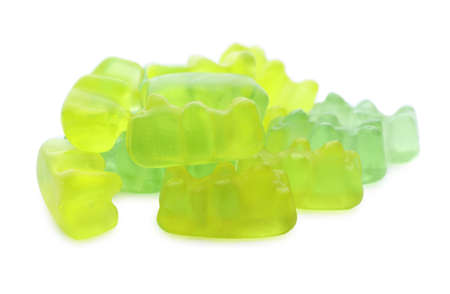 Pile of delicious jelly bears on white background