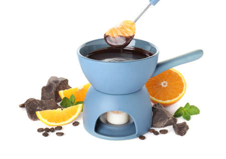Fondue pot with chocolate and fruits on white background 写真素材