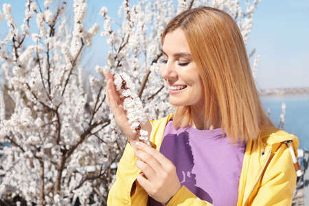 Happy healthy woman enjoying springtime outdoors, space for text. Allergy free concept