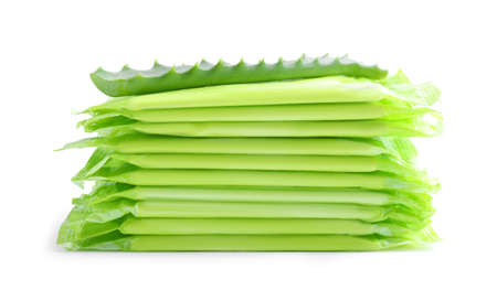 Stack of menstrual pads and aloe leaf on white background. Gynecological care
