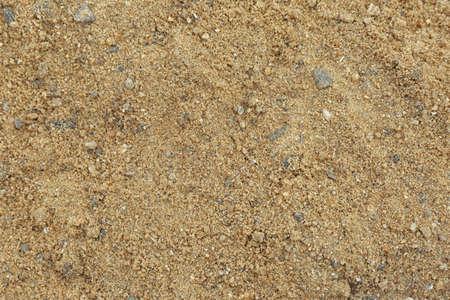 Strukturierte sandige Bodenoberfläche als Hintergrund, Ansicht von oben Standard-Bild
