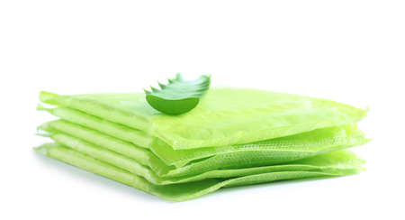 Stack of menstrual pads and aloe leaf on white background. Gynecological care Stock Photo
