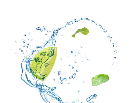 Slice of juicy lime, fresh mint and splashing cold water on white background Foto de archivo