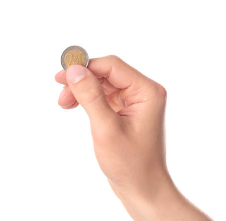 Man holding coin in hand on white background, closeup
