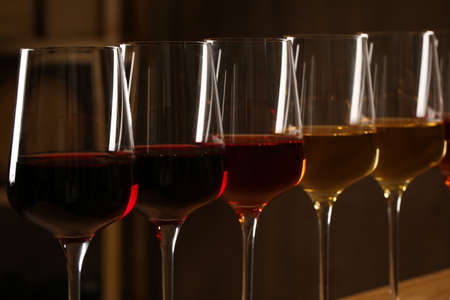 Glasses of different wines against blurred background, closeup. Expensive collection Archivio Fotografico