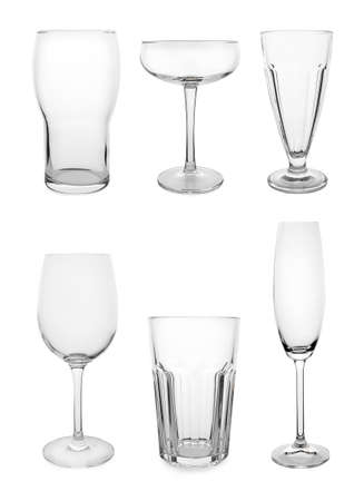 Set of different empty glasses on white background