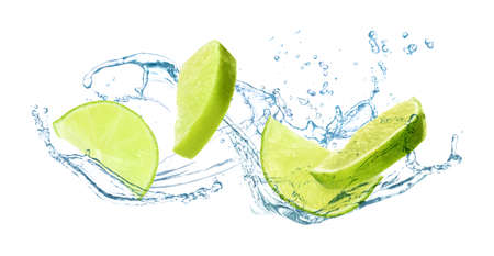 Slices of juicy lime and splashing cold water on white background Фото со стока