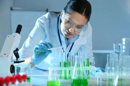 Female scientist working with sample in modern chemistry laboratory